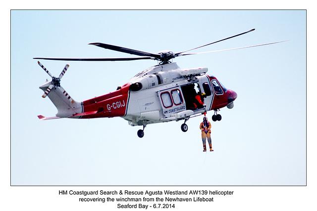 Coastguard Agusta Westland AW139 recovering its winchman - RNLI & Coastguard Joint Exercise - Seaford Bay - 6.7.2014