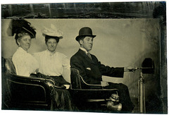 Tintype of Two Women and a Man in an Early Automobile