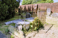 Derelict and damaged tomb