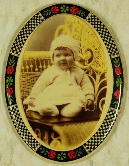 Cute Kid on a Wicker Chair