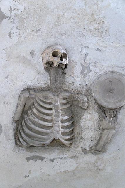 Deceased human set in concrete