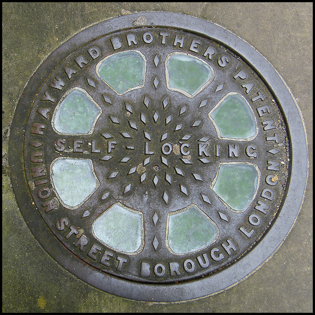 self-locking manhole cover