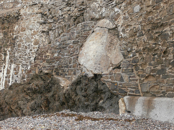 Incredible wall of many types of building, stones, pebbles, concrete, rocks etc.