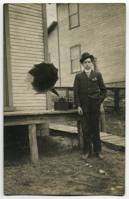 Young Man Posing with an Edison Cylinder Phonograph