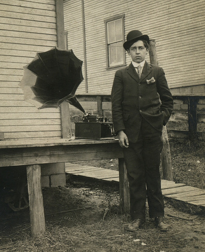 Young Man Posing with an Edison Cylinder Phonograph (Cropped)