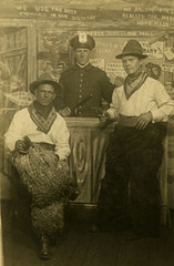 Two Cowboys and a Policeman at Brother Jones' Gin Mill