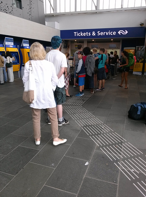 Queueing for a train ticket
