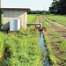 Irrigation ditch full of water