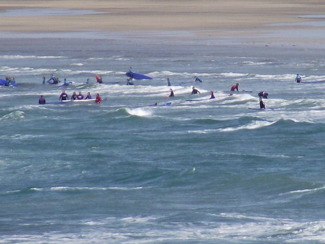 A surf school enjoying themselves