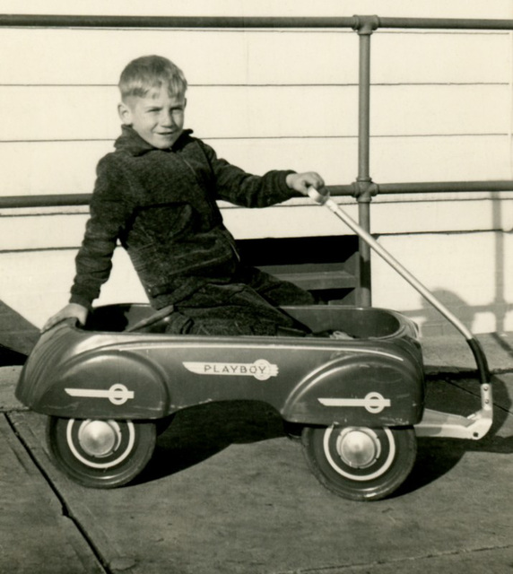 Boy in a Playboy Toy Wagon, 1938