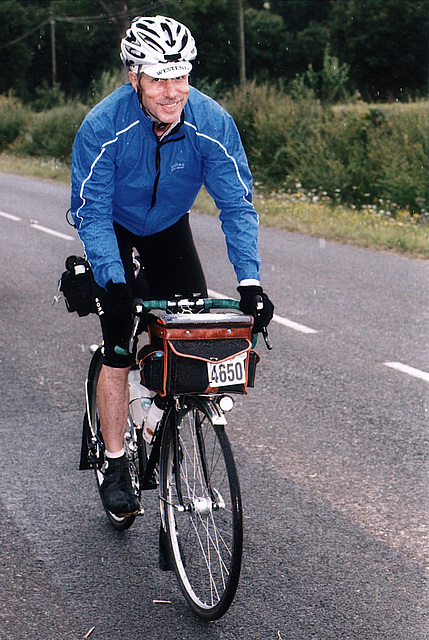 Alan Woods riding in the rain, but still smiling, outbound 2011 PBP