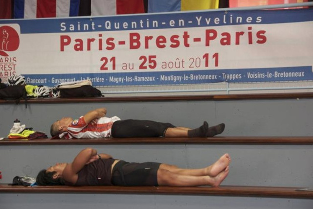 After PBP activity. Sleeping in the bleachers of Gymnase des Droits de l'Homme at the finish control in Guyancourt