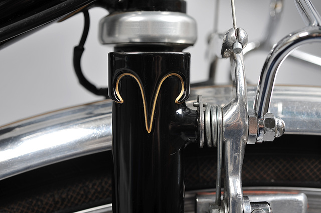 Reworked Vagner fork crown and braze-on center pull brake bosses. Note:  wire run to generator tail light below crown from inside of rack to inside of down tube