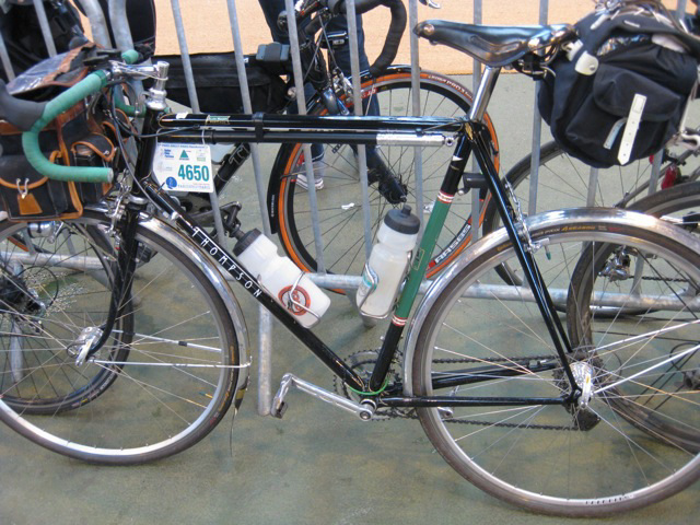 My Thompson randonneuring bike at Brest control. For PBP 2011, I was carrying a saddle bag with extra clothes instead of using a drop bag service. The drop bag service saves weight, but is restrictive