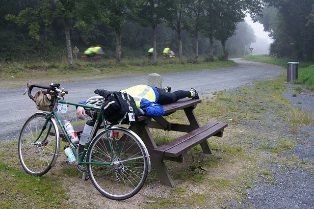 Tired cyclist near the end of PBP 2011 in Elancourt