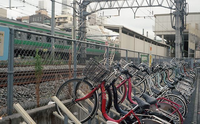Bike parking lot by railway tracks