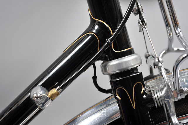 Thinned and tapered lower head lug, down tube gear cable stop for Ergopower shifter, and Vagner fork crown. Note: rack connection to brake pivots.