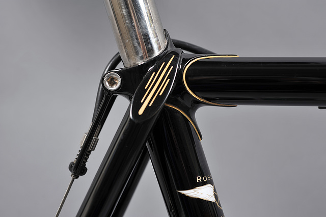 Seat cluster features wrap over seat stays with decorated top eyes.