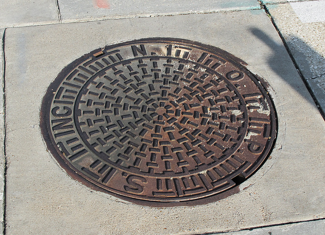 Occult manhole lid in the U.S. bible belt.