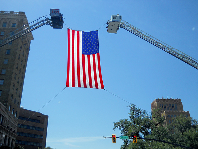 Flag being raised over Washington Blvd in Ogden