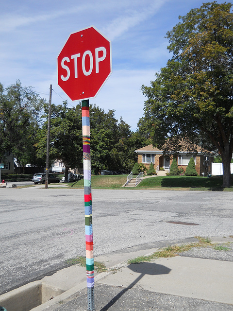 Yarn-bombed stop sign