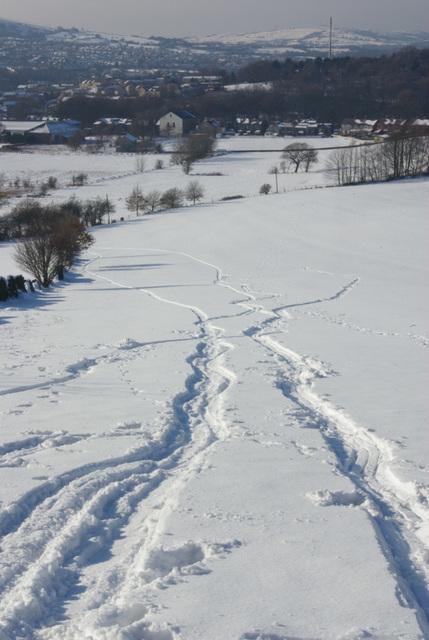 Snow runs towards Glossop