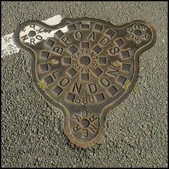 """""""teddy bear"""" manhole cover"""