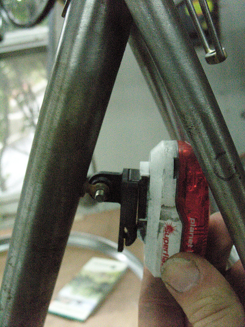 #CT209 Test fitting of supplemental tail light onto the braze on mount on the back of the seat tube (2009)