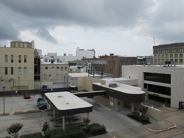 Drivethru banking scene of downtown Galveston during an overcast sky condition.