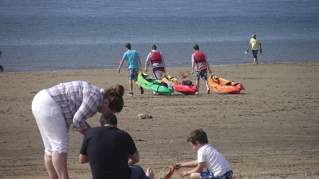 7 people enjoying the beach