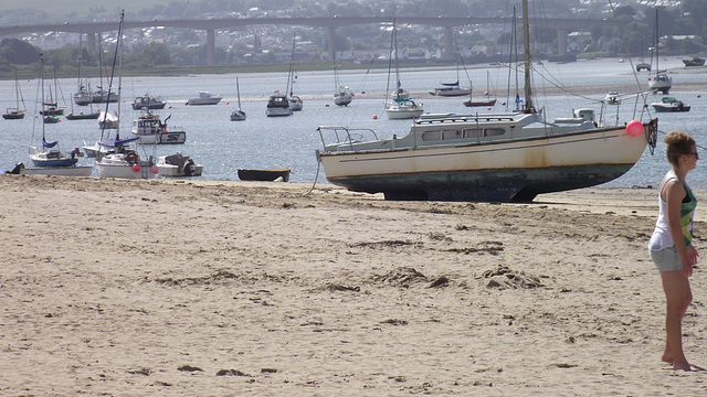 Some boats starting to beach with the tide going out