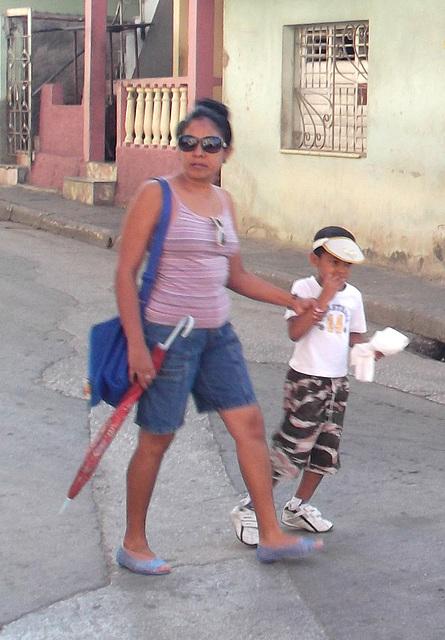 Umbrella cuban mom on flats.
