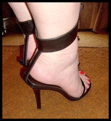 Carla in her Black Fetish High-Heeled Sandals