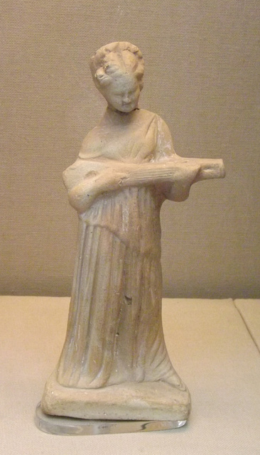 Terracotta Figure of a Woman Playing a Type of Lute in the British Museum, April 2013