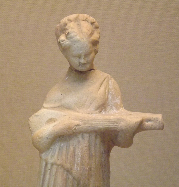 Detail of a Terracotta Figure of a Woman Playing a Type of Lute in the British Museum, April 2013