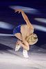 Corkscrew sit spin - Back view
