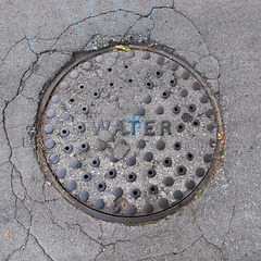 WATER of circles and holes in a cracks area.