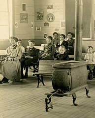 Students and Teacher in a One-Room Schoolhouse, March 1911 (Left)