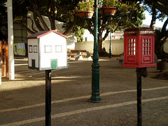 Telephone boxes of taxi rank.