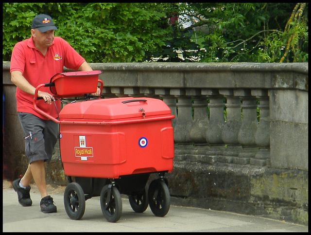 Royal Mail postman with trolley