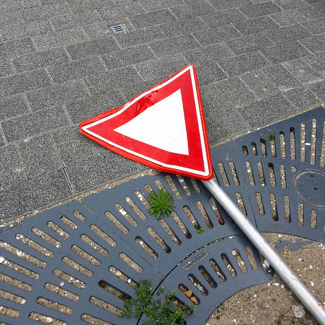 Traffic sign taking it lying down