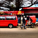 The red tuktuk. The red minibus.