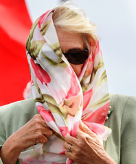 QUEEN CAMILLA'S DISGUISE FOR HER THRID TRIP TO THE BUFFET TABLE.