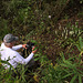Jim Fowler photographing nice group of Spiranthes odorata (Fragrant Ladies'-tresses orchids) (photo by Walter Ezell)