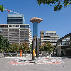 Public art idea: a rock on a column for plaza seating.