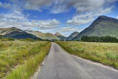 Blue sky over the road in Glen Etive, Argyll, Scotland
