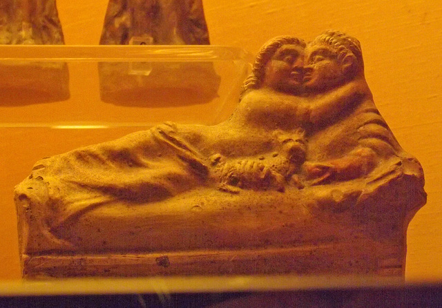 Kissing Couple on a Kline Terracotta Figurine from Pompeii in the Naples Archaeological Museum, July 2012