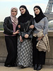 Two Muslim sisters with a friend