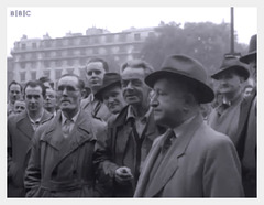 raincoat and trilby mob