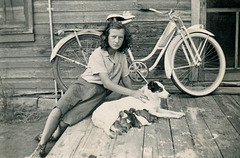 Girl with Bicycle, Dog, and Puppies